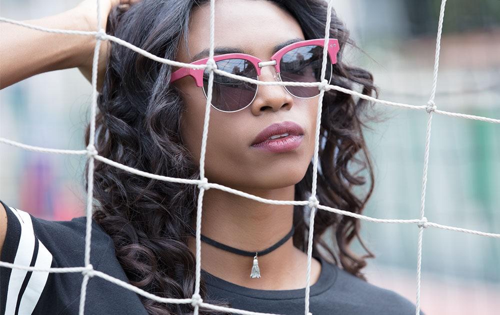 Girl wearing red sunglasses