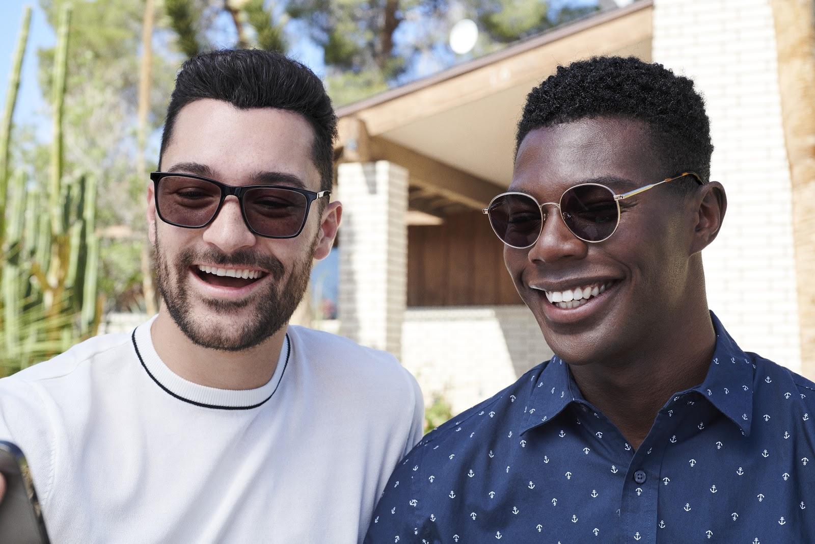 Two men wearing glasses for bigger noses