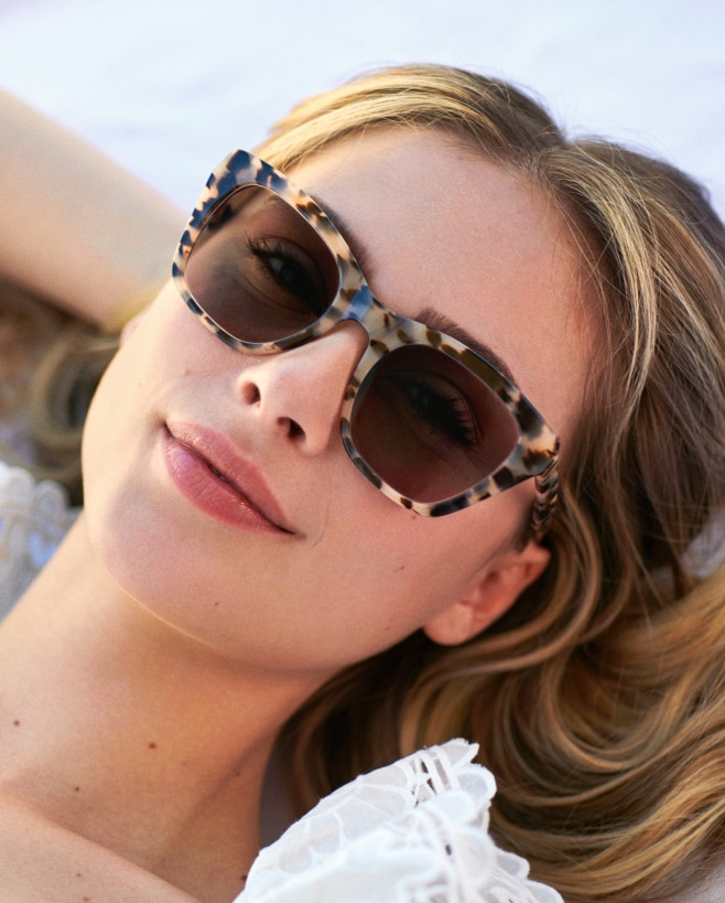 A woman wearing inexpensive ivory tortoise sunglasses