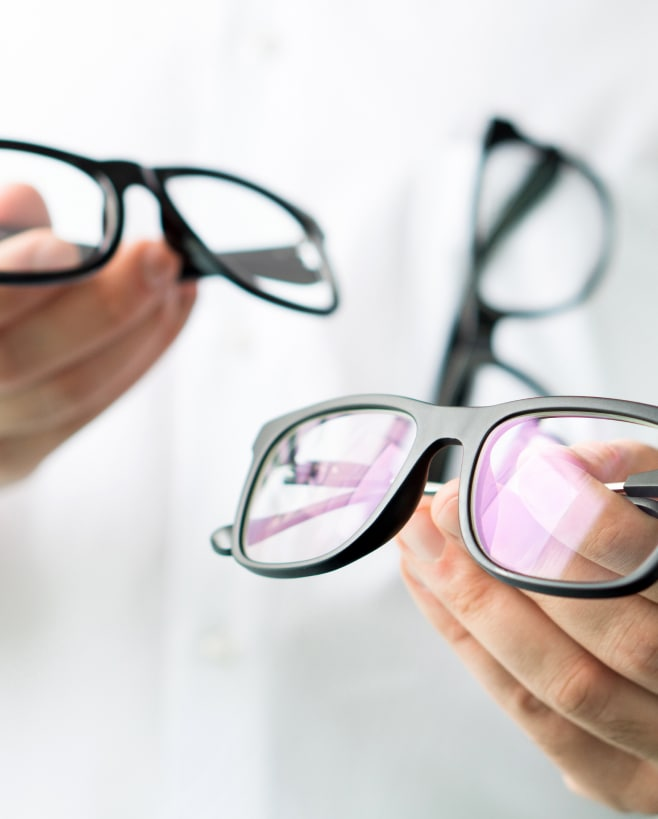 Two pairs of glasses with bifocal and progressive lenses