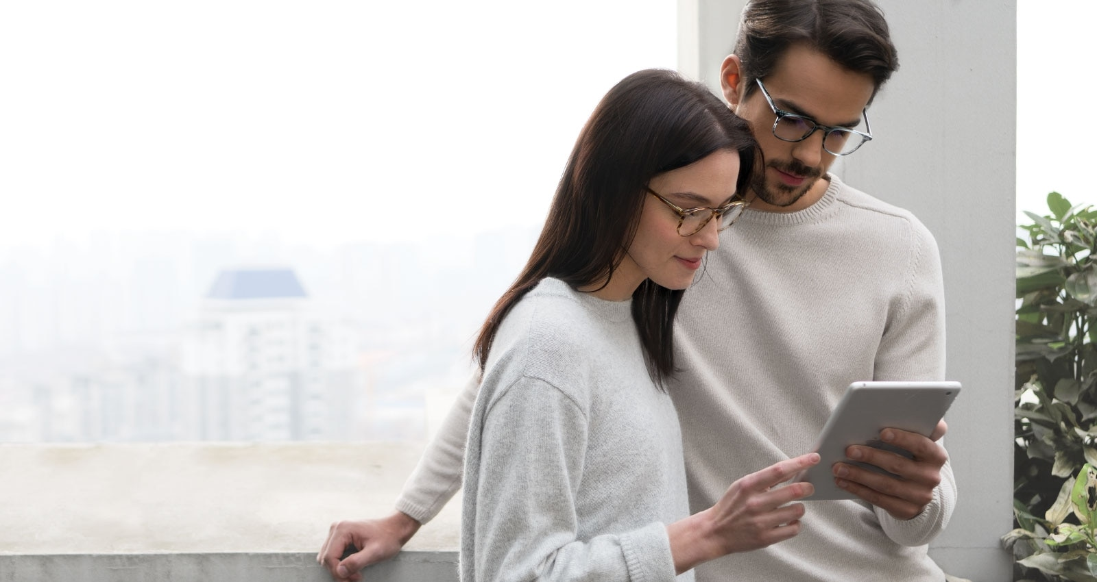 Man and woman with EyeBuyDirect glasses at the computer