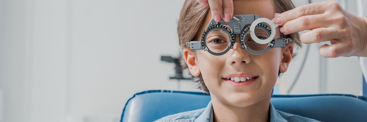 A kid getting an eye exam
