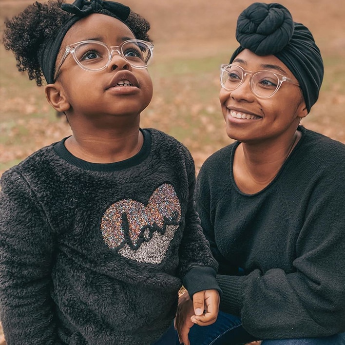 A mother and daughter wearing glasses